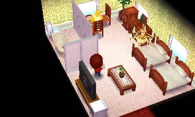 まずは洋室。普通ながらもキングサイズのツインベッドで快適そうです。