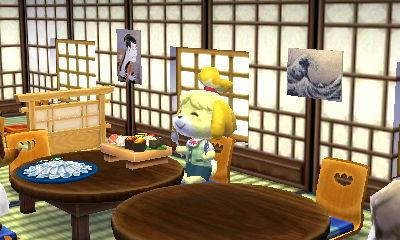 しずえさんはお寿司とふぐ刺し(多分たぬきち社長のおごり)に夢中。手に持っているのはスプーンとフォークですが…。