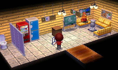 待合室。秋なのでストーブを用意しました。できれば正面にホームに繋っているような出入口が欲しかったのですが…。ダミーの出入口を作るために二部屋にすると狭くなるので、結局待合室だけに。