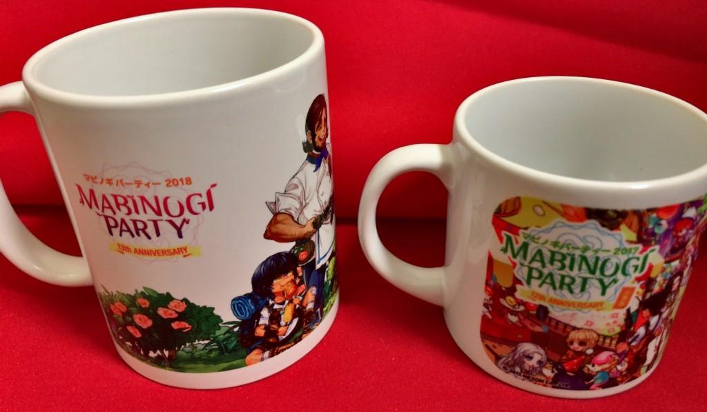 左が今年貰ったお土産のマグカップ。右の出張版で貰ったマグカップと比較して大きくなって普段使いしやすそうです。絵柄は出張版の方が緻密ですが…。